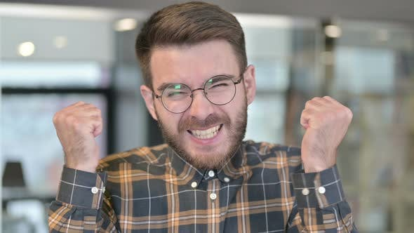 Thumbnail for Portrait of Young Designer Celebrating Success in Office
