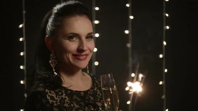 Woman with Sparklers and a Glass of Champagne