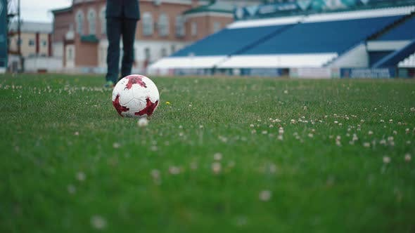 Thumbnail for Young Man in Trousers, Runs To the Football Field and Hits the Ball, Close-up