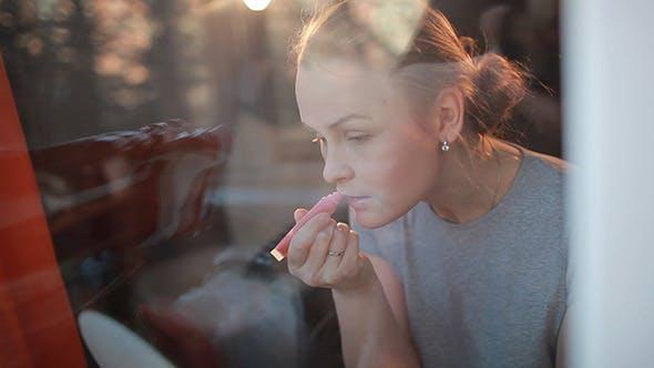 Thumbnail for Girl Making Her Lips Shine