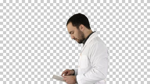 Thumbnail for Portrait of male doctor walking and using digital tablet Alpha