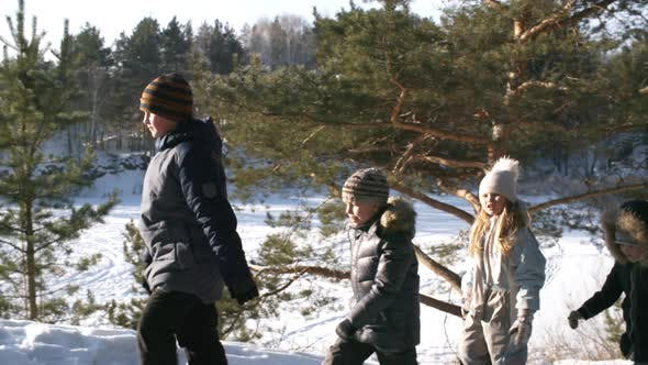 Thumbnail for Family Standing Over Snowy Frozen Lake