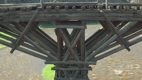 Timber Wooden Bridge Made of Tree Logs