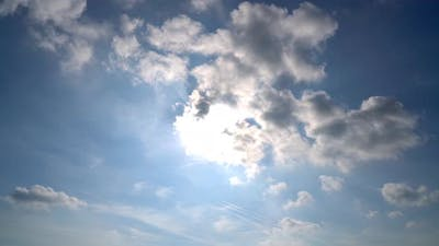 Sunny blue sky with fluffy clouds