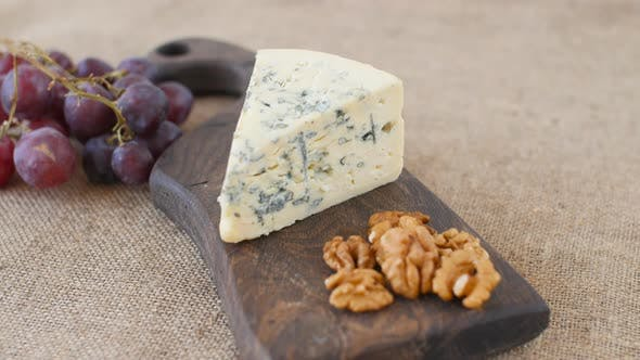 Thumbnail for Blue Cheese and Nuts Rotate on a Wooden Serving Board