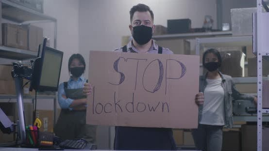 Thumbnail for Man Holding Anti-lockdown Message