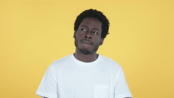 Thumbnail for Thinking African Man Got New Idea, Yellow Background