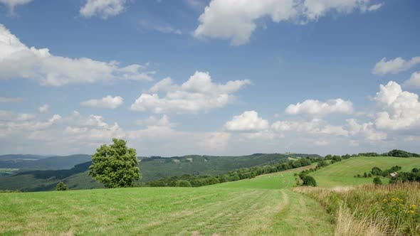 Cover Image for Clouds over Green Landscape