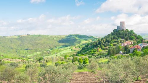 Time lapse: Rocca d'Orcia, a medieval village and fortress in Orcia Valley, Tuscany, Italy. The ston