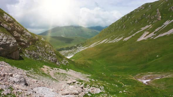Aerial Shot Valley and Slopes of Beautiful Caucasus Mountains, Covered with Dense Green Grass