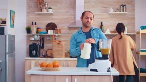 Pouring Milk in Blender