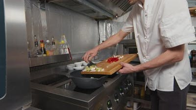 Adding Vegetables To Wok Pan