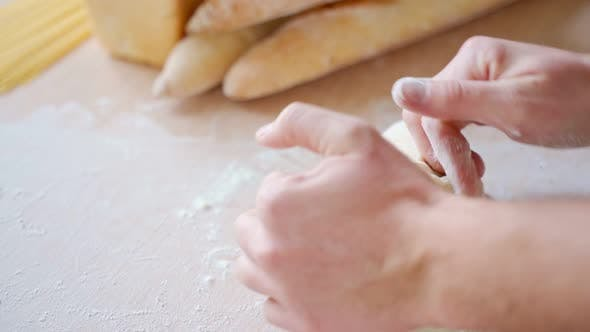 Thumbnail for Close Up View of Baker Hands Kneading the Dough on the Table. Manufacturing Process, Working Hard