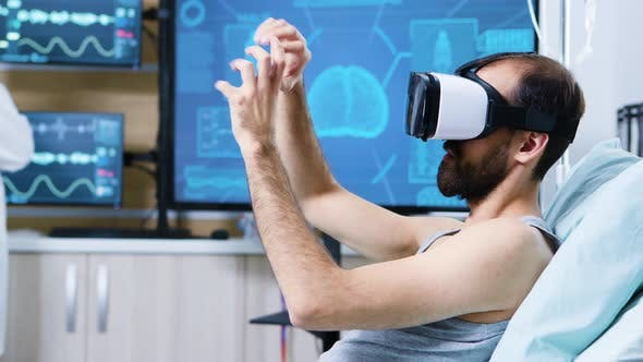 Patient with Virtual Reality Goggles in a Modern Facility for Brain Research
