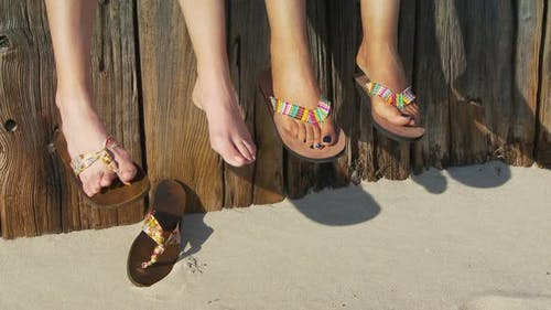 Close-up of women's feet in sandals