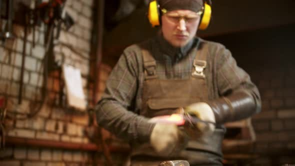 Blacksmith Forging a Knife in Workshop