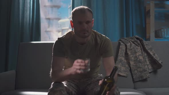 Portrait Professional Military Man Sits in Depression and Frustration with Alcohol and Drinks