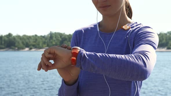 Thumbnail for Woman Uses Watches and Then Look in the Camera