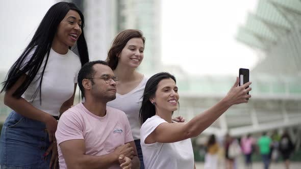 Smiling Young People Making Facial Expressions for Selfie