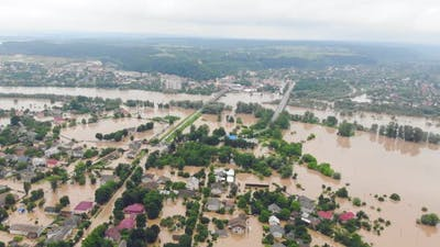 Environmental Disaster and Climate Change. Aerial View River That Flooded the City and Houses