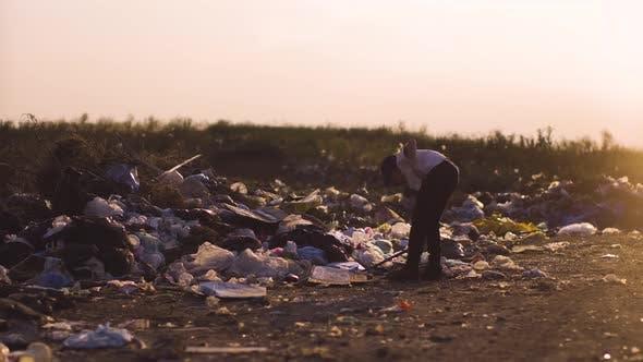 Thumbnail for Boy Kicking Dust in Dump