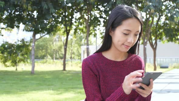 Cover Image for Woman using mobile phone at outdoor