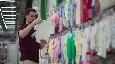 Man Buying Baby Bodysuit