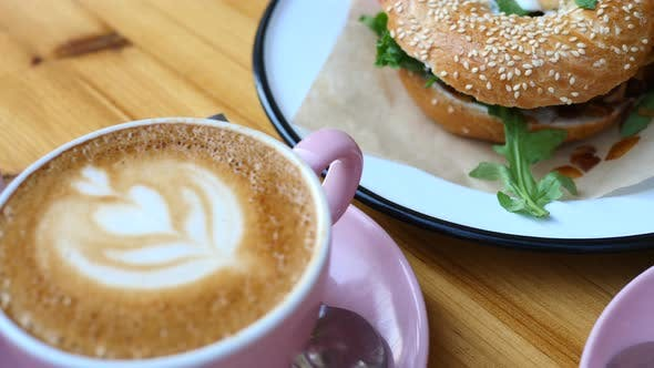 Thumbnail for Closeup Of Coffee Latte And Bagels For Breakfast