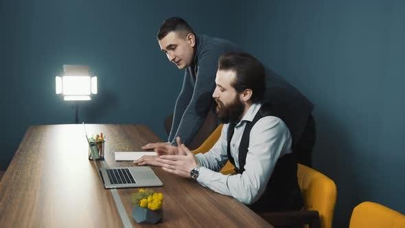 Two Young Bloggers Prepare To Go Live in a Small Makeshift Studio