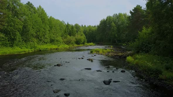 Thumbnail for Flying Up From the Fast Forest River in Karelia, Russia