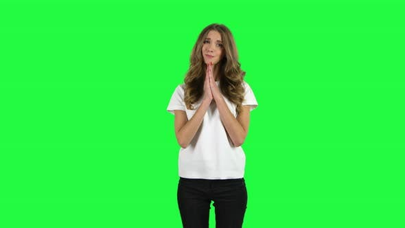 Cover Image for Lovable Girl Keeps Palm Together and Asks for Something . Green Screen