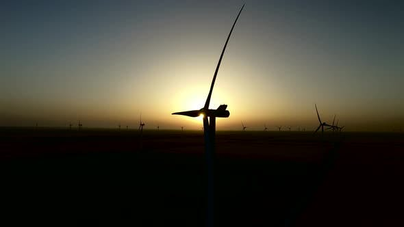 Thumbnail for Sunset Over the Wind Turbines on a Wind Farm in the Quiet Summer Night, Silhouette, Aerial Survey