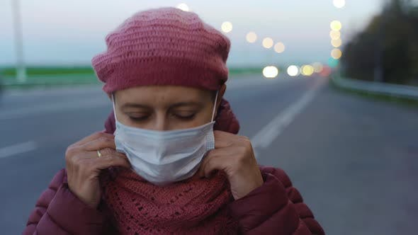Thumbnail for Woman On The Road With Car Wearing Face Mask To Protect Against Virus Covid 19