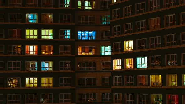 Light in the Windows of a Multistory Building. Time Lapse