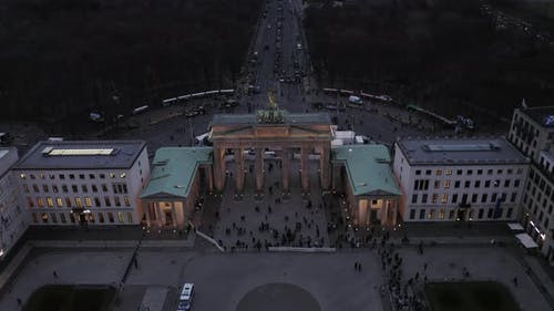 AERIAL: Over Brandenburger Tor with City Traffic Lights in Berlin, Germany
