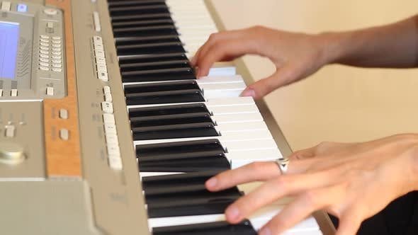 Thumbnail for Girl Playing On Electric Piano