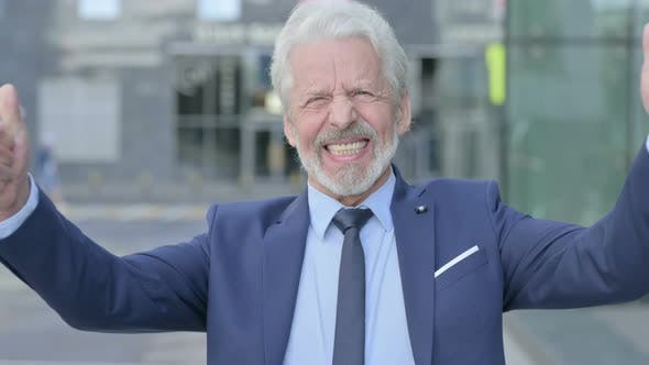 Excited Old Businessman Celebrating Success Outdoor