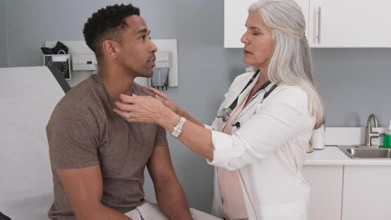 Thumbnail for Attractive black male having doctor checkup at health clinic