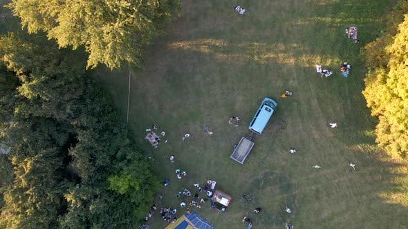 Aerial View of People Looking at How Hot Air Balloons Prepare for an Summer Evening Flying in Park