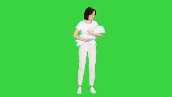 Beautiful Mother Holding Her Cute Baby on a Green Screen Chroma Key