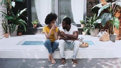 black couple conversating outdoor