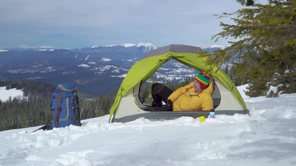 Thumbnail for Tourist Relaxes in a Tent in the Mountains in Winter