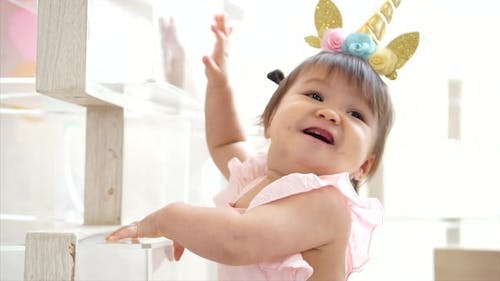 Cute Little Adorable Toddler Infant Baby Girl Smiling in Beautiful Dress and Unicorn Headband