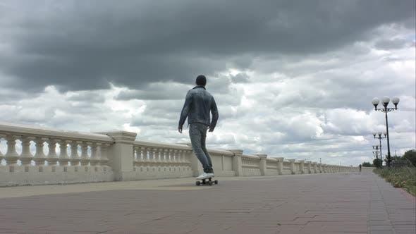 Thumbnail for Man Riding a Skateboard and Loosing Balance.