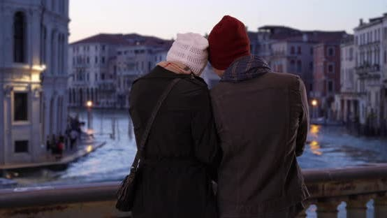 Thumbnail for Rear view of happy couple looking out at the Grand Canal in evening