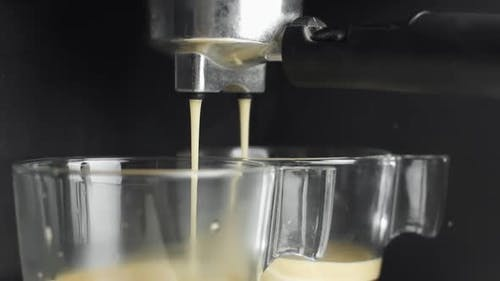 Making an Esspresso Using Proffesional Coffee Machine on a Black Background