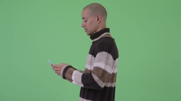 Thumbnail for Profile View of Bald Multi Ethnic Man with Phone Being Taken Away
