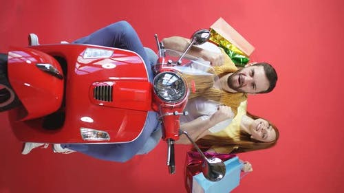 Beautiful Couple on a Motorcycle Happy Together, Young Family Shopping on a Scooter, Isolated