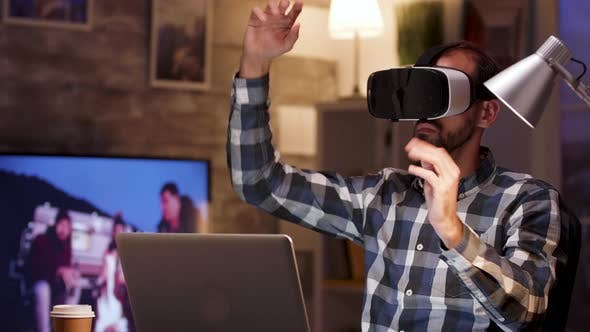 Thumbnail for Bearded Businessman Using Virtual Reality Goggles in Home Office