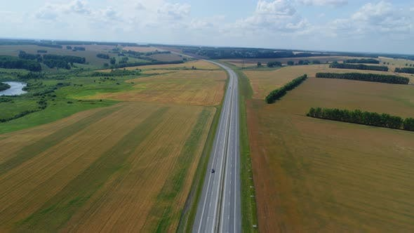 Thumbnail for Hyperlapse Drone Flies Over the Highway, Cars Are Driving